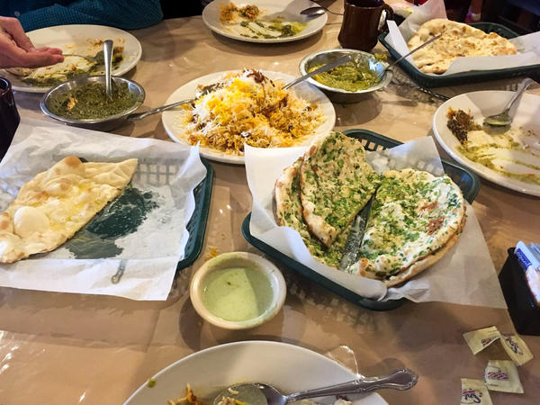 Chef Kaiser Lashkari greeted NPR to his restaurant, Himalaya, with a spread including garlic naan, butter naan and saag paneer. His restaurant has become an institution in multi-ethnic Houston.