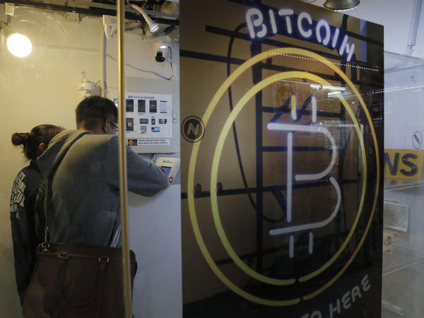 People use the bitcoin ATM in Hong Kong, on Friday.