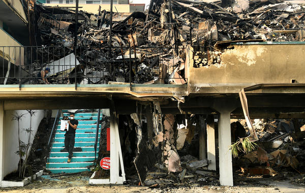 Residents move their belongings Friday after the Thomas Fire razed most of an apartment building in Ventura, Calif.