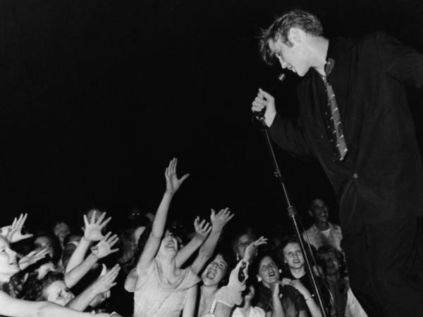 Elvis Presley and fans in 1956.