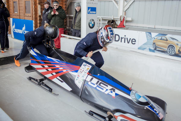 Bobsled pilot and two-time Olympic medal recipient, Elana Meyers Taylor, and US National team member Lolo Jones, left, push off the start during a training run in Lake Placid.