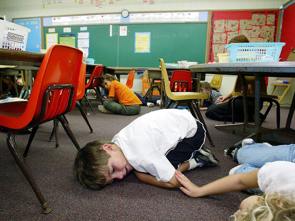 Kindergarten students in Oahu, Hawaii, lie on the floor during a lockdown drill in 2003.