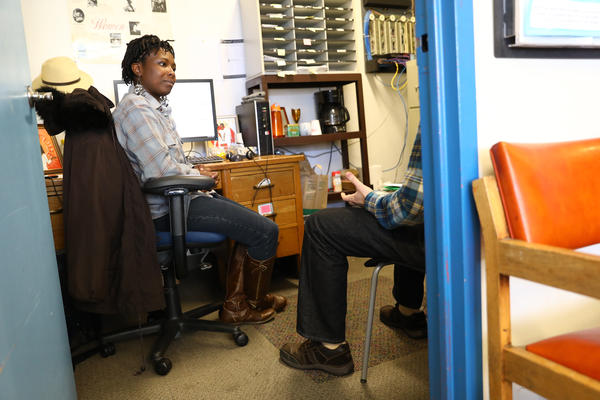 Shenise Morgan talks to a client in her office at the Tenant Resource Center in Madison, Wis. The center accepts walk-in appointments for anyone in Wisconsin needing advice on landlord, tenant or housing issues.