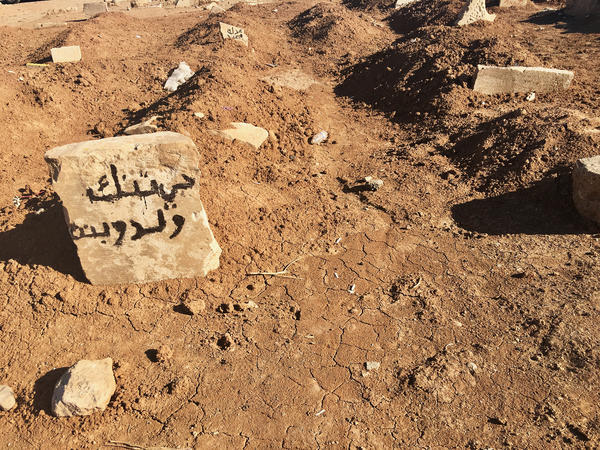 "A headstone in Mosul cemetery bears the words ""boy and girl,"" along with the name of the neighborhood where they died. By some counts, more than 5,000 civilians died in nine months of fighting in Mosul – more than the number of ISIS fighters killed."