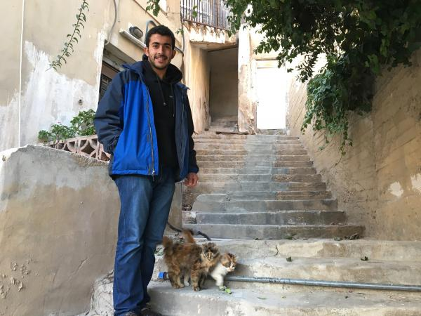 Yahya Abu Romman stands outside his family's home in downtown Amman. The 22-year-old was deported from the U.S. after landing in Chicago at the end of January with a valid visa. He says border officers questioned why he holds a Jordanian passport when he was born in Syria.