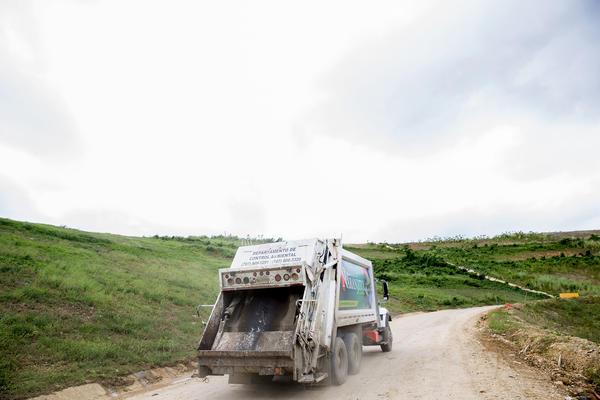 A truck drives past a closed section of the municipal landfill in Toa Baja, which is near Puerto Rico's capital city of San Juan.