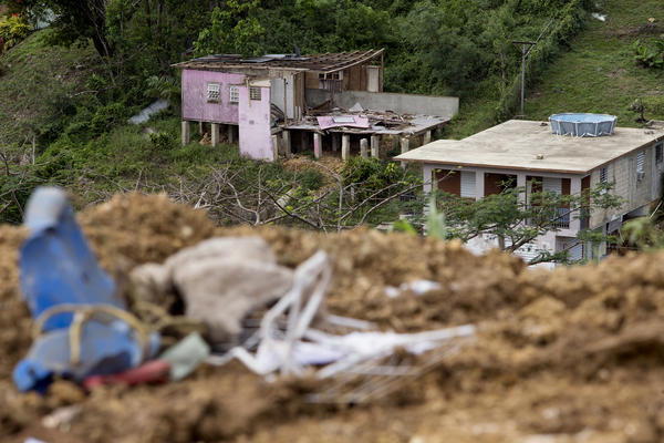 Homes damaged by Hurricane Maria in the Candelario neighborhood sit adjacent to the Toa Baja landfill.