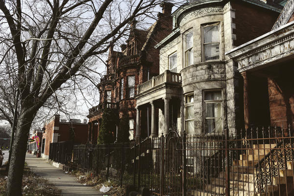 Victorian-style homes line Garfield Boulevard in the Englewood neighborhood. The village program allows seniors to stay in their own homes.