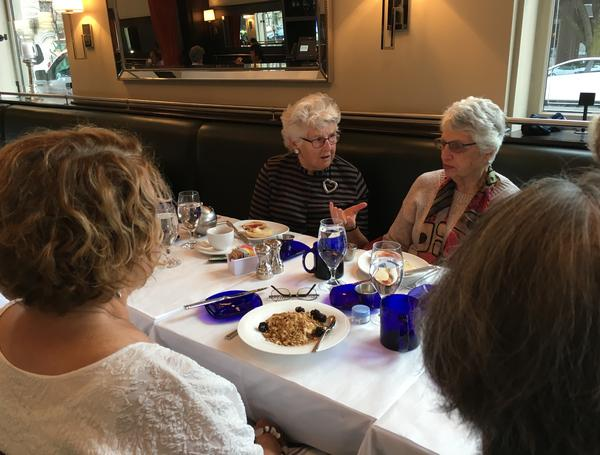 Susan McWhinney-Morse (center), one of the founders of Beacon Hill Village, participates in a political discussion breakfast, while Muriel Feingold listens.