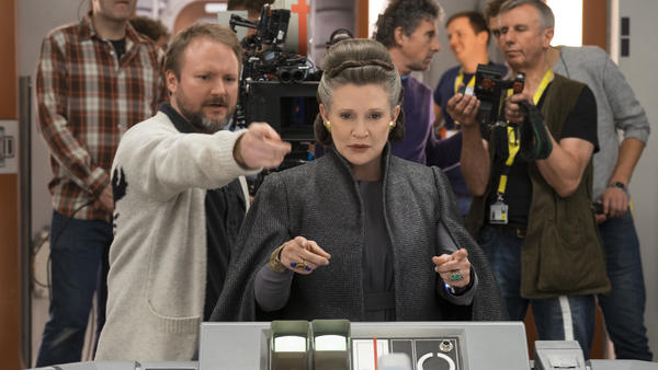 Rian Johnson directs the late Carrie Fisher on the set of <em>Star Wars: The Last Jedi</em>.