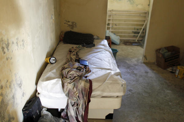 A bed is seen inside an abandoned house, which has no running water or electricity, now occupied by Rivera's family.