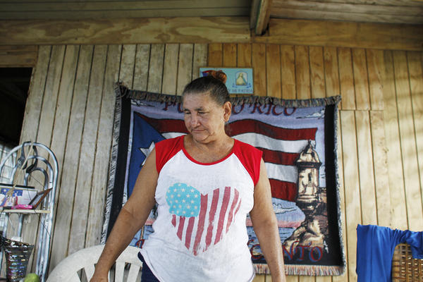 Felicita Garcia, 66, looks inside her recently repaired house, which was completely destroyed by the storm.