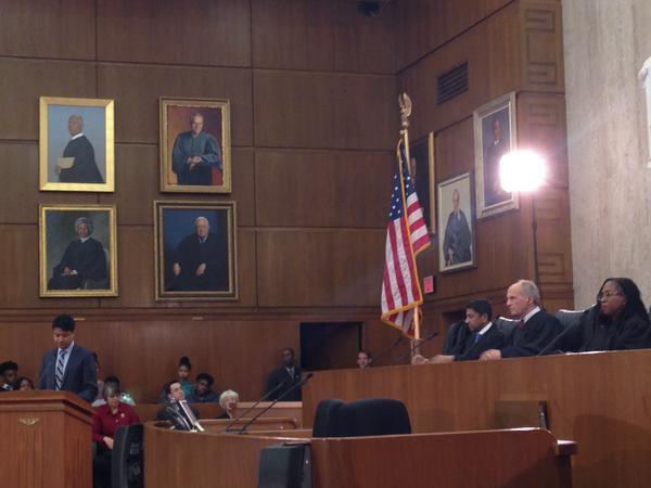 Law clerk Zayn Siddique, at the lectern, argues as the lawyer for Tinker, before Judges Sri Srinavasan, David Tatel and Ketanji Jackson.