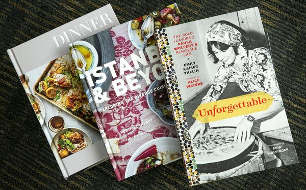 "Chef Kathy Gunst's top three cookbook picks for 2017 (left to right): ""Dinner: Changing the Game,"" by Melissa Clark and Eric Wolfinger; ""Istanbul & Beyond: Exploring the Diverse Cuisines of Turkey,"" by Robyn Eckhardt and David Hagerman; ""Unforgettable: The Bold Flavors of Paula Wolfert's Renegade Life,"" by Emily Kaiser Thelin, Andrea Nguyen, Eric Wolfinger and Toni Tajima. (Robin Lubbock/WBUR)"