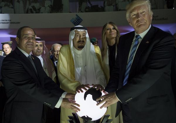President Trump, Saudi Arabia's King Salman bin Abdulaziz al-Saud (center) and Egyptian President Abdel Fattah el-Sisi (left) place their hands on an illuminated globe as First Lady Melania Trump watches during the inauguration of the Global Center for Combating Extremist Ideology in Riyadh in May.