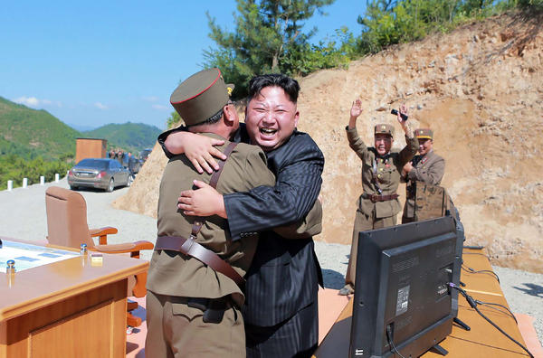 This picture taken on July 4, and released by North Korea's official Korean Central News Agency on July 5, shows North Korean leader Kim Jong Un celebrating a successful test-fire of the intercontinental ballistic missile Hwasong-14.
