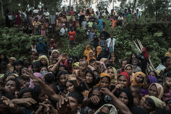 Rohingya refugees clamor for bamboo poles and tarpaulins to build shelters at a makeshift camp near Kutupalong, Bangladesh, on Sept. 3.