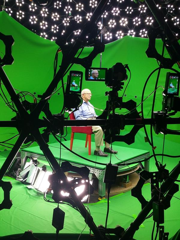 Sam Harris, surrounded by green screens, in preparation for his hologram.
