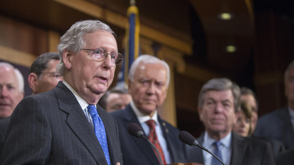Senate Majority Leader Mitch McConnell (left) speaks at the press conference after the senate vote of the tax reform bill on Wednesday in Washington, D.C