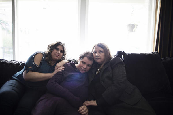 Patricia (from left), Natalie and their mother, Rosemary, sit in their home in Northern California. Natalie, a woman with an intellectual disability, is unable to speak. She couldn't explain what was wrong and doctors couldn't figure out why she was in pain.