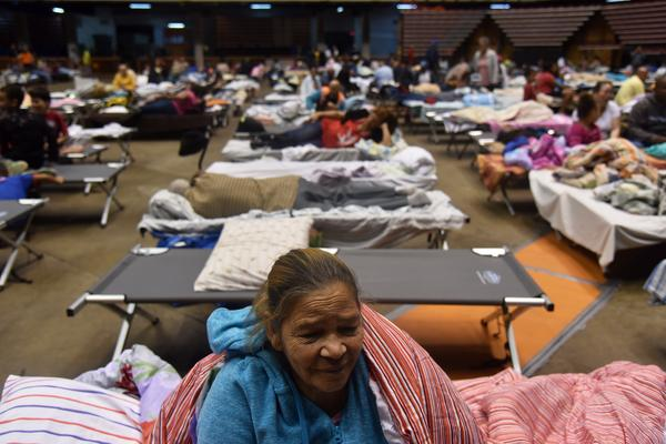 Puerto Ricans take refuge ahead of Hurricane Maria in the Clemente Coliseum in San Juan on Sept. 19.