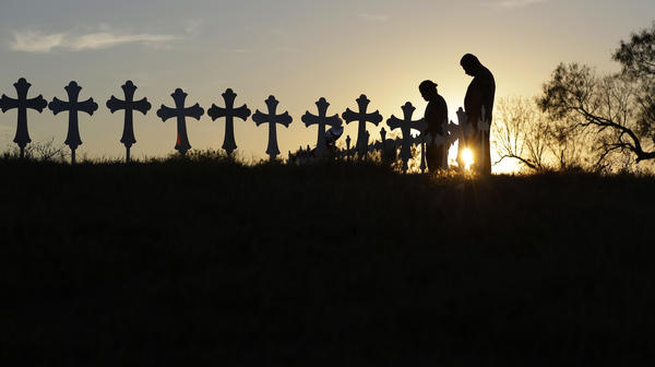 Kenneth and Irene Hernandez pay their respects as they visit a makeshift memorial with crosses placed near the scene of a shooting at the First Baptist Church of Sutherland Springs, Texas. A man opened fire inside the church in the small South Texas community in November, killing and wounding many.