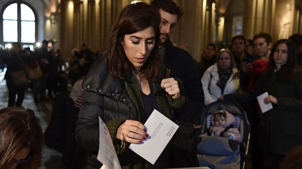 A woman casts her ballot in the Catalan regional election at a Barcelona polling station on Thursday.