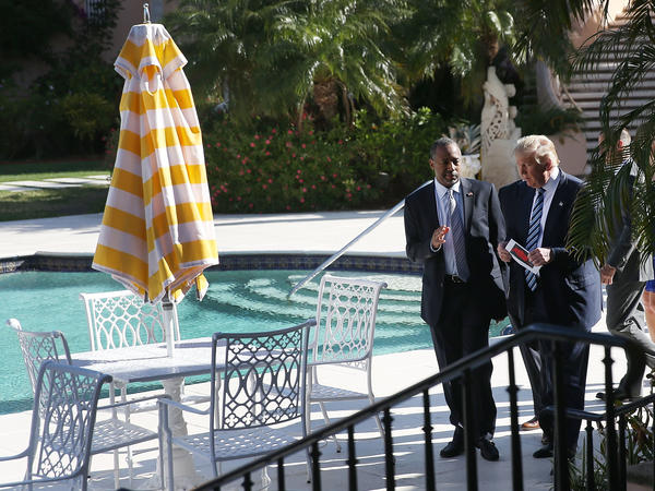 Then-candidate Donald Trump walks with former rival Ben Carson at the Trump's Mar-a-Lago Club in Florida in March 2016. As president, Trump has spent far more time at his own resorts than at the presidential retreat, Camp David.
