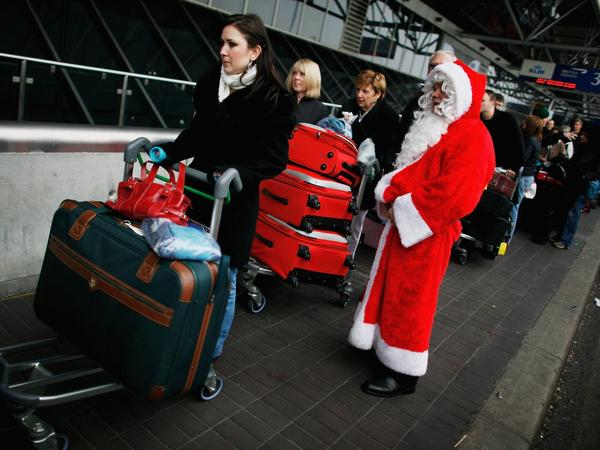 Santa takes advantage of the airport's moving walkway. How else could he reach every kid in the world in one night?