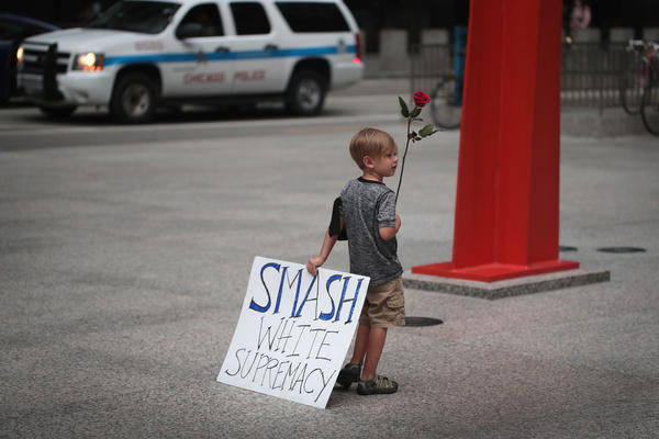 Four-year-old Leo Griffin leaves a Chicago protest against the alt-right movement held to remember the victims of violence at a rally in Charlottesville, Va.