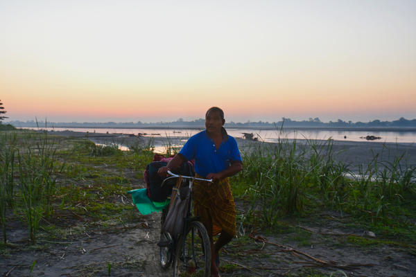 Jadav Payeng covers the distance from the island banks to his forest on his bicycle, carrying the supplies he uses while working on his forest and abundant vegetable farm.