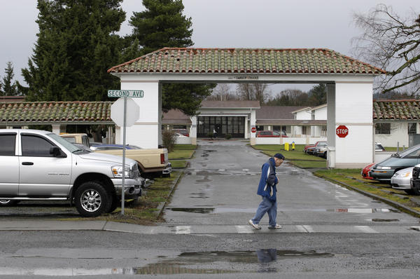 A resident walks across the campus of the Rainier School in 2010. Rainier houses about 310 adults.