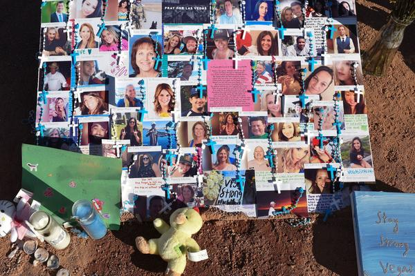 The 58 fatalities in October's mass shooting in Las Vegas were all caused by gunshot wounds, the county coroner and medical examiner said Thursday. A makeshift memorial on the south end of the Las Vegas Strip a few days after the shooting has photos of some of those who were killed.