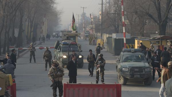 Afghan security personnel block a road near the site of a suicide attack in Kabul on Monday. A suicide attacker on foot blew himself up near a compound belonging to the Afghan intelligence agency in Kabul on December 25, killing six civilians, officials said.