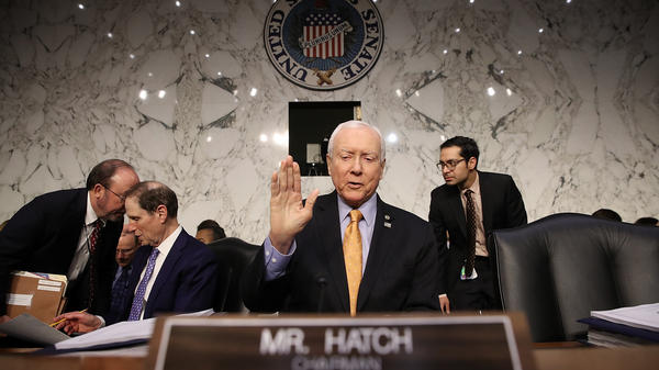 Senate Finance Committee chairman Orrin Hatch (R-Utah) gestures before a committee meeting on Nov. 15 in Washington, D.C.