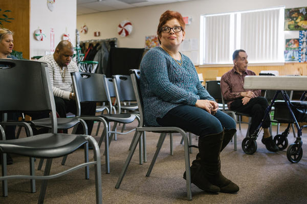 Pauline sits after practice for a Christmas show with fellow group members of a day program at the Arc Northeastern Pennsylvania. Pauline, who has intellectual disabilities, has been with the Arc program since 2014, after an emergency removal from her previous caretaker's home by Adult Protective Services when she was sexually assaulted.