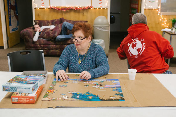 Pauline, 46, puts together a puzzle at her day program. Adults with intellectual disabilities are among groups with one of the highest rates of sexual assault in the United States, according to previously unpublished sex crime data from the Justice Department.