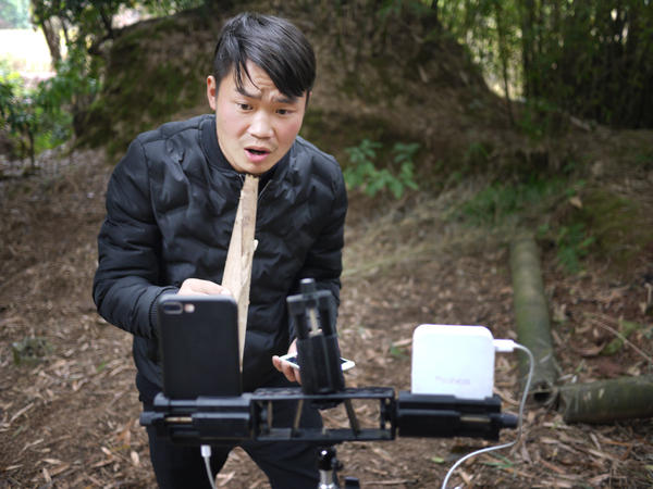 Farmer Liu Jin Yin croons into a makeshift microphone during a livestream for viewers from all over China.