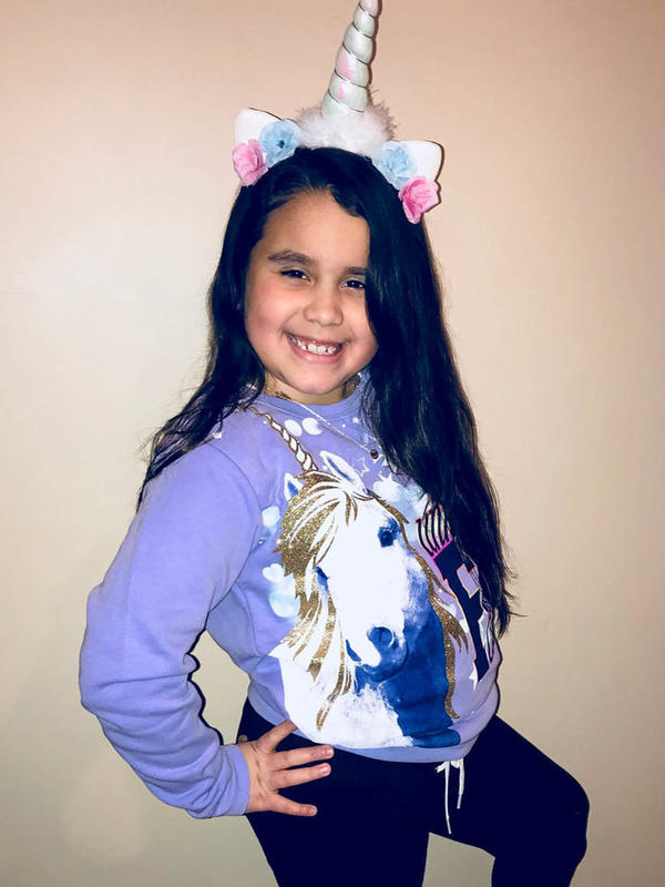 Brianna Freeman, 8, poses as her favorite mythical creature, the unicorn.