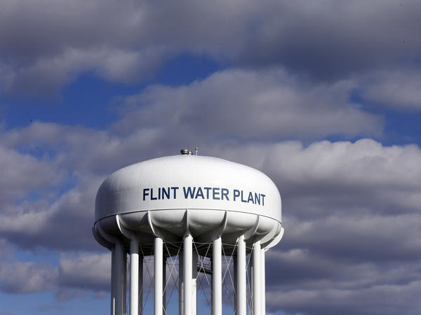 Lawyers say the city of Flint is violating the terms of a major settlement agreement reached in March to improve the quality of the city's water.
