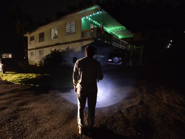 Jose Luis Gonzalez of Morovis illuminates his path with a lantern on a street of the Barrio Patrón.