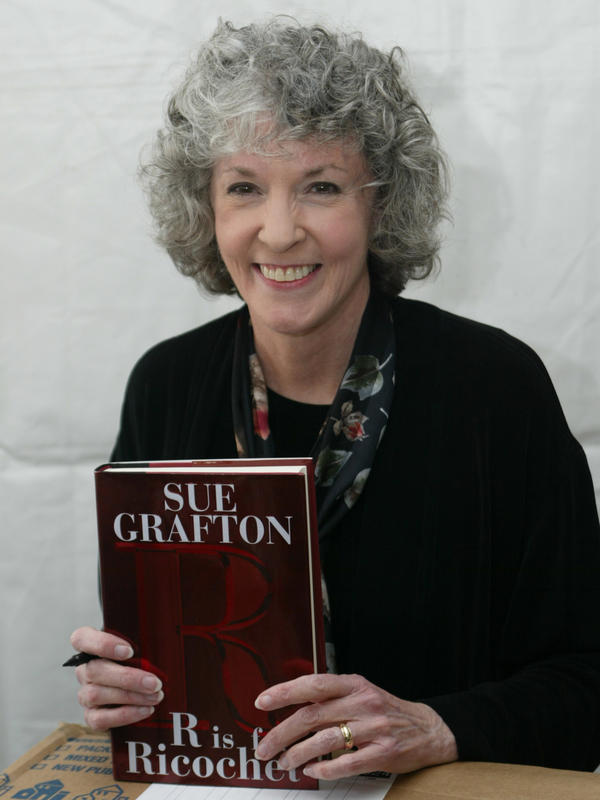 Author Sue Grafton, author of 25 mysteries featuring detective Kinsey Millhone, died Thursday at age 77. Grafton is seen here with a copy of her book <em>R is for Ricochet</em> in 2005.