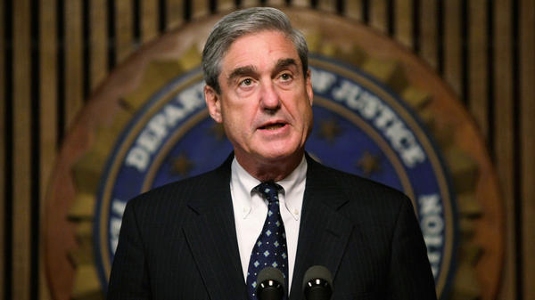 Robert Mueller speaks during a 2008 news conference at FBI headquarters in Washington during his term as FBI director.