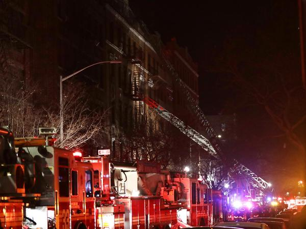 Officials said the Thursday night fire in the Bronx started in a first-floor kitchen by a 3-year-old boy who was playing with burners on a stove.