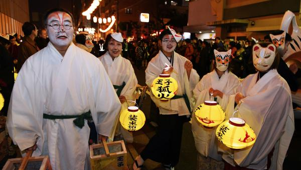 Residents in fox makeup participate in the Oji Fox parade to thank the outgoing and welcome the incoming year at the Oji Inari shrine in Tokyo.