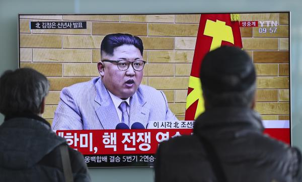 South Koreans watch North Korean leader Kim Jong Un's televised New Year's address, at the Seoul Railway Station on Monday. Kim said the United States should be aware that his country's nuclear forces are now a reality, not a threat.