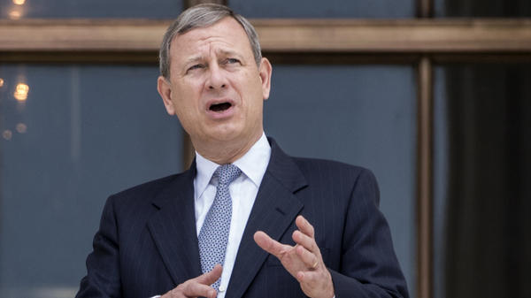 Chief Justice John Roberts stands outside the Supreme Court in Washington, D.C., in June, following new Associate Supreme Court Justice Neil Gorsuch investiture ceremony, a ceremony to mark his ascension to the bench.