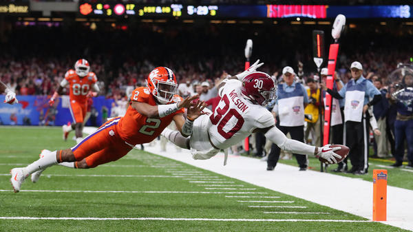 Linebacker Mack Wilson of the Alabama Crimson Tide stretches the ball into the endzone after an interception Monday night at the Sugar Bowl New Orleans. Alabama will appear in their third straight national title game after beating clemson 24-6.