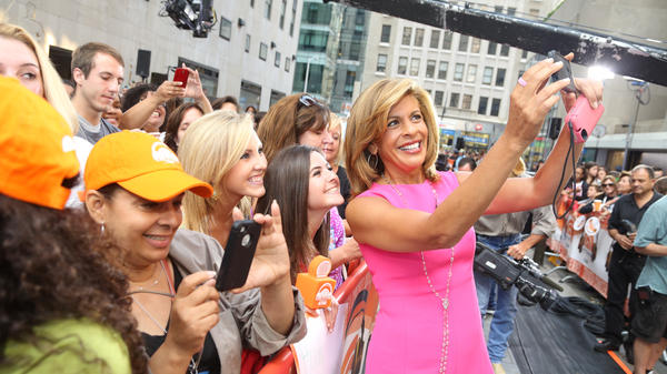 Hoda Kotb poses with guests outside of the <em>Today </em>show studios in 2014. Kotb has just been named co-anchor of the show, replacing longtime co-anchor Matt Lauer.
