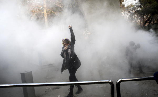 A woman takes part in a protest inside Tehran University. Iran is experiencing its largest anti-government protests since the disputed presidential election in 2009.